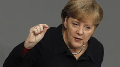 Merkel calls for tighter euro fiscal union