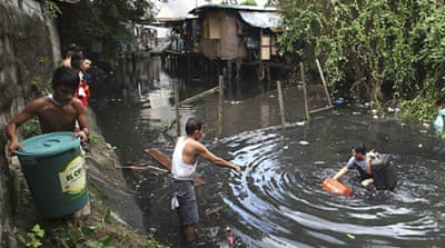 Philippine flood death toll surges