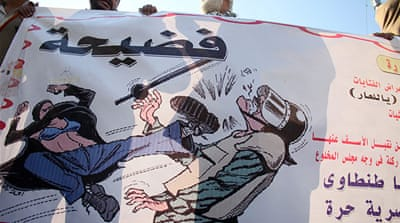 The 'blue bra woman', who was attacked in December 2011, became a symbol of those women who were beaten and sexually assaulted during protests in Egypt [EPA]