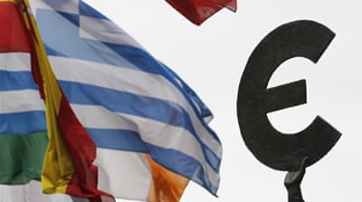 Ratings agency threatens eurozone downgrade