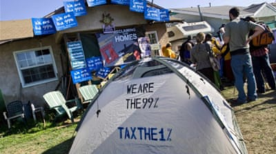 Occupy protesters target foreclosed homes