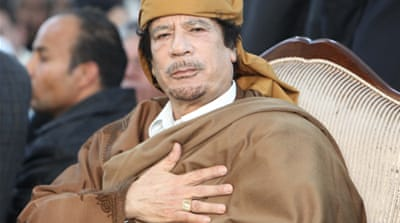 Gaddafi defiant as state teeters