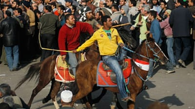 The camel-and-horses assault at the height of last year's 18-day sit-in at Tahrir Square was a turning point [EPA]