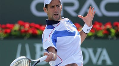 Djokovic deals double blow to Federer