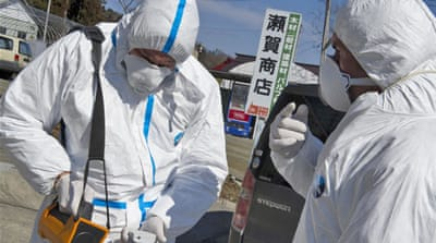 Engineers toil against radiation in Japan