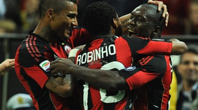 Milan close in on title