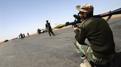 Libya rebels claim strike on regime officials