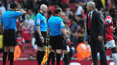 Arsenal's title hopes crushed late on