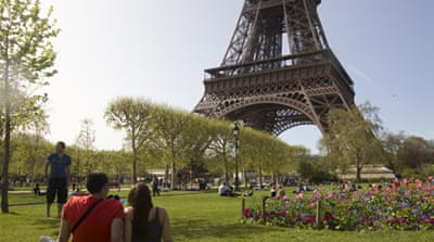 Employees say Eiffel Tower's facilities are insufficient to welcome the daily flood of visitors [AFP]