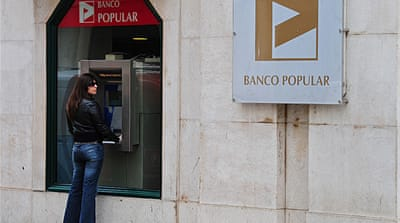 Credit agency raises pressure on Portugal