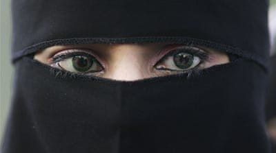Assad overturns ban on face veil