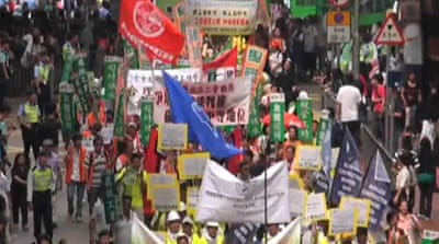 Hong Kong rallies decry low wages