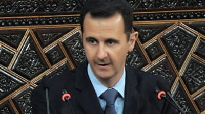 British PM backs 'safe passage' for Assad