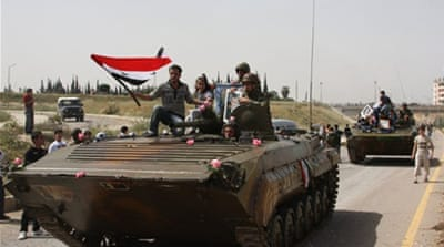 Deaths reported as tanks shell Syrian cities