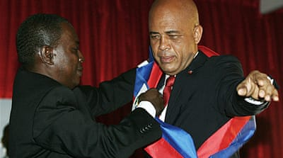 Haiti swears in singer as president