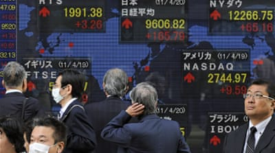Japan falls back into recession
