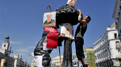 Spaniards vow to maintain protests