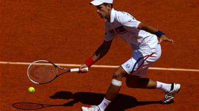 Djokovic eases through to second round