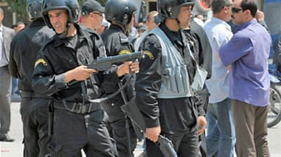 Tunisian police break up protests