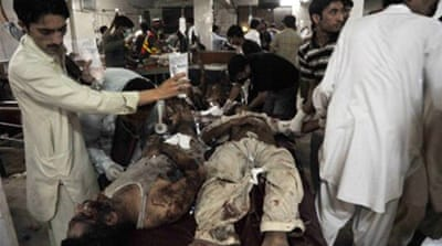 Blasts hit market in Pakistan's Peshawar