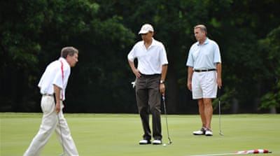 Obama and rivals play golf amid budget debate