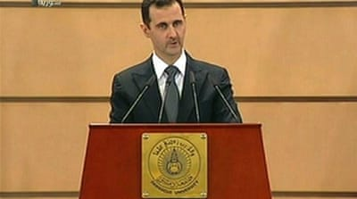 Assad gives mixed signals in speech