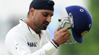 Harbhajan and Raina limit damage for India
