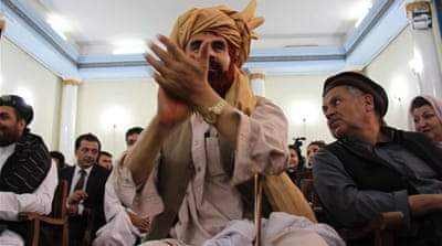 Unseated Afghan MPs threaten protests
