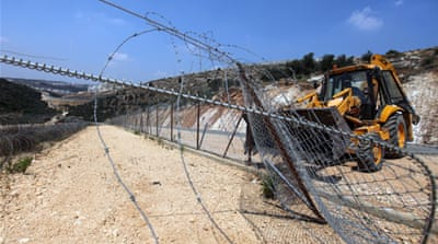 Israel reroutes West Bank barrier at Bilin