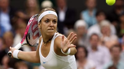 Lisicki downs Bartoli to reach semis