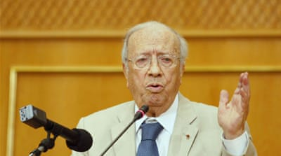 Tunisia PM says unrest aims to derail polls