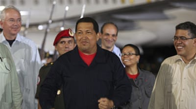 Chavez back in Venezuela after treatment