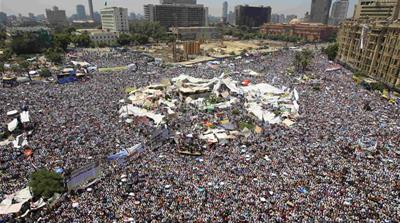 Visions collide in a sweltering Tahrir Square