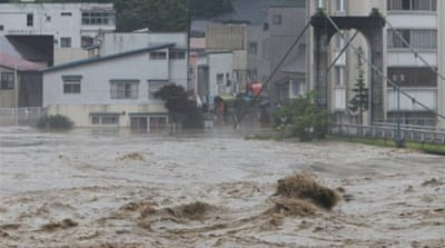 Floods threaten thousands in northern Japan