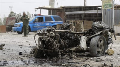 Twin blasts kill dozens near Baghdad