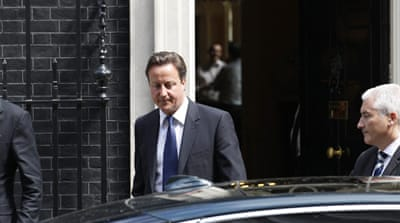 Cameron calls for UK phone hacking inquiry