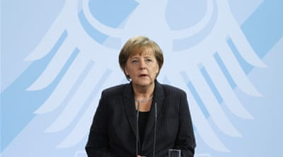 Merkel pressed to handle EU financial crisis