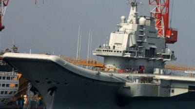 China's first aircraft carrier sets sail