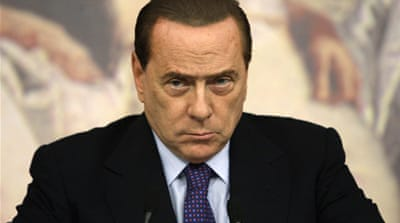 Berlusconi denounces Italy debt downgrade