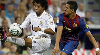 Barcelona and Madrid draw in Super Cup clash