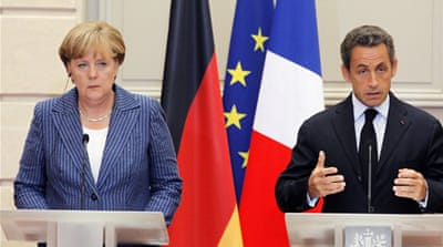 Merkel and Sarkozy push closer eurozone ties