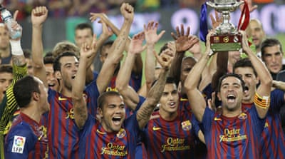 Messi fires Barcelona to Super Cup win