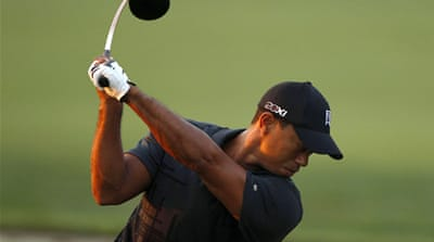 Woods gets back into the swing of it