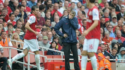 Touchline ban adds to Wenger's woes