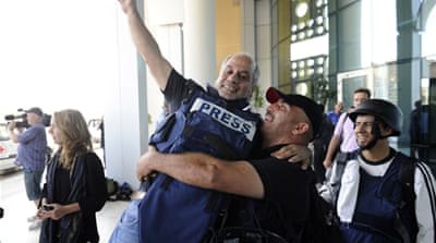 Journalists freed from Tripoli hotel
