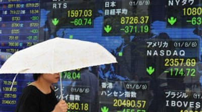 Global markets tumble on debt uncertainty