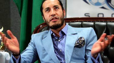 Battles rage as Gaddafi son watched in Niger