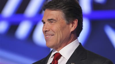 Republican candidates target Perry in debate