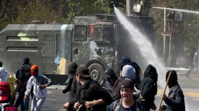 Chile education talks begin amid protests