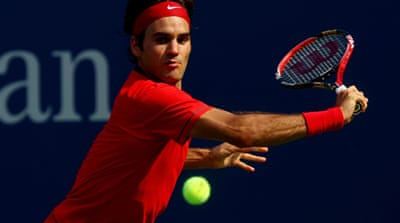Federer digs in at US Open